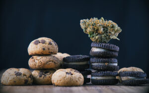 Cannabis nugget over top of baked goods banner